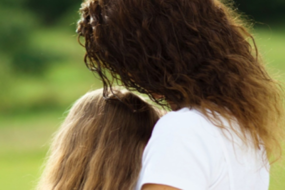 Picture of a woman hugging a young girl